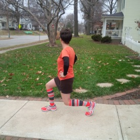 Kate doing a pre-run stretch before our nice December 26 run. Notice the cool socks, which Santa left under the tree...